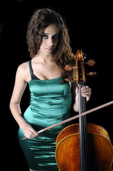 Cellist On A Black Background Royalty Free Stock Photography