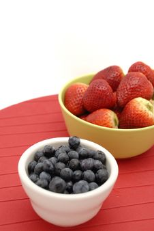 Blueberries And Strawberries In Green Bowl Stock Photos