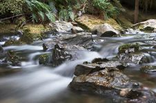 River With Rocks And Milky Water Stock Photography