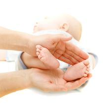 Free Baby S Feet In Parent S Hands Royalty Free Stock Photos - 8506008