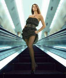 Free Woman On The Escalator Royalty Free Stock Images - 8506809