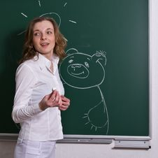 Free Young Woman Is Drawing On Blackboard. Royalty Free Stock Image - 8506846
