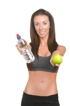 Fitness Woman Apple And Water Royalty Free Stock Images