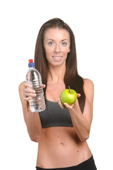 Fitness Woman Apple And Water Stock Photos