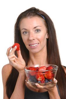Free Fitness Woman Eating Fresh Fruit Royalty Free Stock Image - 8508286