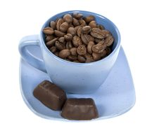Free Cup With Coffe Beans And Two Chocolate Candys Royalty Free Stock Image - 8510426