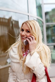 Free Beautiful Blondie In A Coat Talks On The Phone Royalty Free Stock Photos - 8512408