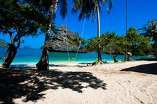 Free Wooden Swing Against Paradise Beach Scene Royalty Free Stock Images - 8514499