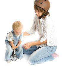 Free Mother And Child Toy And Bicycle Royalty Free Stock Image - 8519086