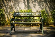 Empty Public Bench In Afternoon Sun Royalty Free Stock Photo