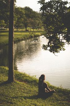 Free Woman Sitting On Grass By Lake Royalty Free Stock Images - 85126719