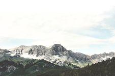 Free White Clouds Over Grey Mountain Range Stock Photos - 85129033