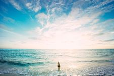 Free Woman Standing Facing Ocean Under White And Blue Sky Stock Photography - 85129782