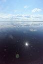 Free River View With Clouds Reflected In It, The Sun In The Frame And The Reflection Of The Sun, Volga, Russia Stock Images - 85150984
