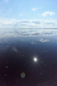River View With Clouds Reflected In It, The Sun In The Frame And The Reflection Of The Sun, Volga, Russia Stock Images