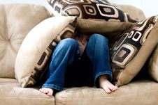 Free Boy Hiding In Couch Cushions Stock Images - 85156324