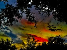 Free Colorful Sunset Over Tree Tops Stock Image - 85163981