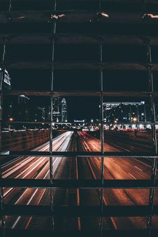 Free Timelapse Photography Of Road At Night From Behind A Bar Royalty Free Stock Photos - 85192088