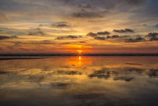 Free Sunset In Cloudy Skies Over Water Royalty Free Stock Images - 85192239