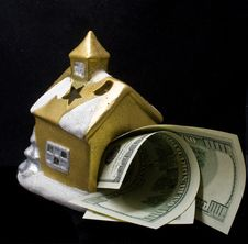 The Small House With Dollars Royalty Free Stock Image