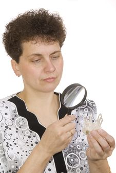 Curly Woman With Magnifying Glass And Stone Stock Image