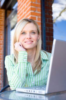 Free Business Woman Sitting At A Cafe Working Stock Image - 8523411