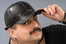 Free The Man In A Black Peak-cap. Royalty Free Stock Photography - 8523947