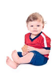 Little Baby Sits With Cookies In Hands Stock Photography