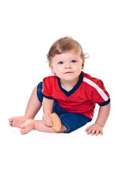 Free Curious Baby Crawls With Cookies In Hand Stock Photo - 8524950
