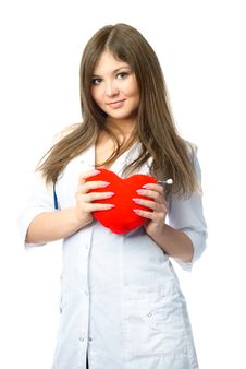 Cardiologist With A Heart Shaped Pillow Royalty Free Stock Images