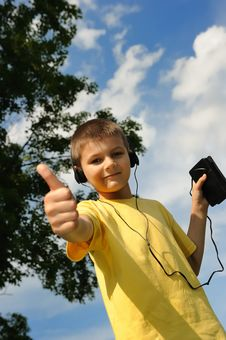 Free Boy Listens To Music Royalty Free Stock Photography - 8525637