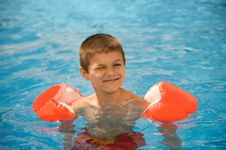 Boy Swims In The Pool Royalty Free Stock Image