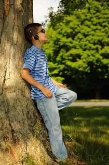 Free Boy Listens To Music Stock Images - 8525714