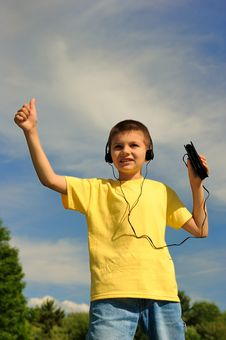 Free Boy Listens To Music Royalty Free Stock Photography - 8525827