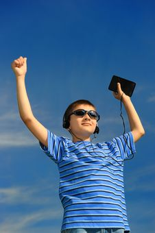 Free Boy Listens To Music Royalty Free Stock Photography - 8525867