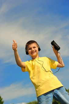 Free Boy Listens To Music Stock Photo - 8525910