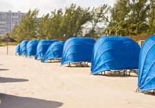 Blue Beach Shelters On Windy Beach Stock Image