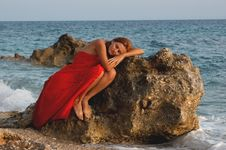 Free Girl Relaxing On A Rock Stock Photography - 8527402