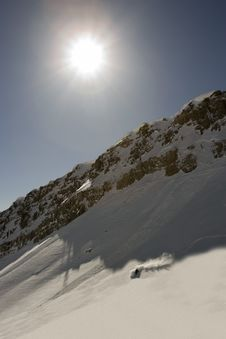 Skier Under The Sun Royalty Free Stock Photography