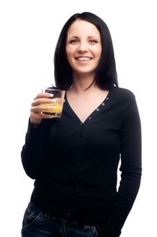 Woman Drinking Glass Of Orange Juice Royalty Free Stock Photography