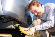 Free Man Putting Banana Into Car Exhaust Stock Photos - 8529463