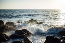 Free Photo Of Blue Ocean Wave Coming To The Rocky Shore Royalty Free Stock Photography - 85218667
