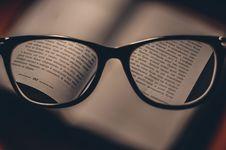 Free Black Frame Eyeglasses Behind Opened Book At Page 162 Stock Image - 85281411