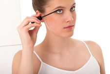 Free Body Care - Young Woman Apply Mascara Stock Photos - 8535483