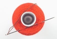 Sewing Spool With A Needle Stock Photos