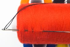Sewing Spool With A Needle Royalty Free Stock Image