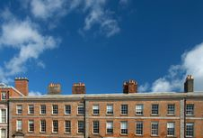 Red Brick Irish Building With Row Of Chimney Stock Image