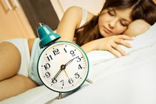 Free Sleeping Woman With The Alarm Clock Royalty Free Stock Photography - 8539857