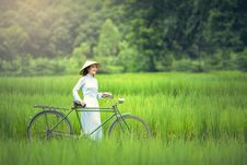 Free Woman With Bicycle On Grass Stock Photo - 85361460