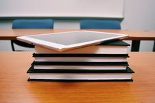 Free Tablet On Stack Of Books In Classroom Stock Image - 85361721
